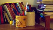 Upcycling can be super simple- making boxes for pencils out of jars and cans